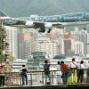 SIGHTSEERS AND PLANE LOVERS WATCH FINAL FLIGHTS AT KAI TAK AIRPORT